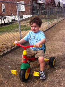 Finny rides a tricycle