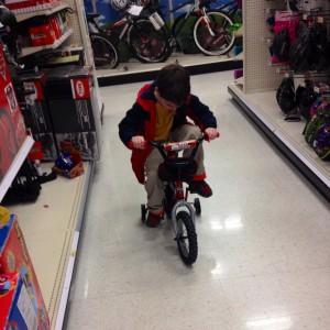 Finny pedals a bike in Target